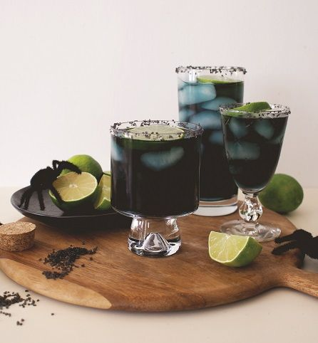 """Created by: Lauren Saylor, A Fabulous Fete   With a few extra steps and ingredients, you can turn all of your favorite cocktail recipes into """"spooky"""" versions for your upcoming Halloween parties. Margaritas are our go-to drinks for get-togethers. And since I didn't want to stray too far from our favorite recipe, I just changed up the color to make it festive and just the right amount of creepy for the holiday."""