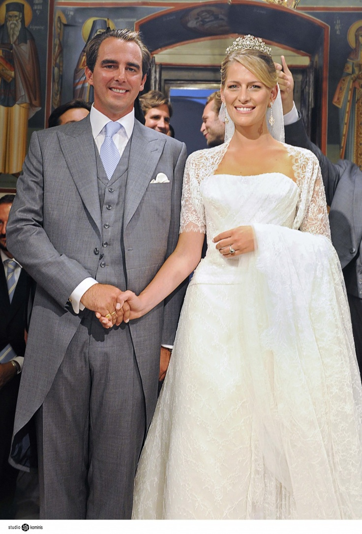 Prince Nikolaos, son of Greece's deposed King Constantine, and his bride Tatiana Blatnik holds hands during their wedding on the Greek island of Spetses August 25, 2010.