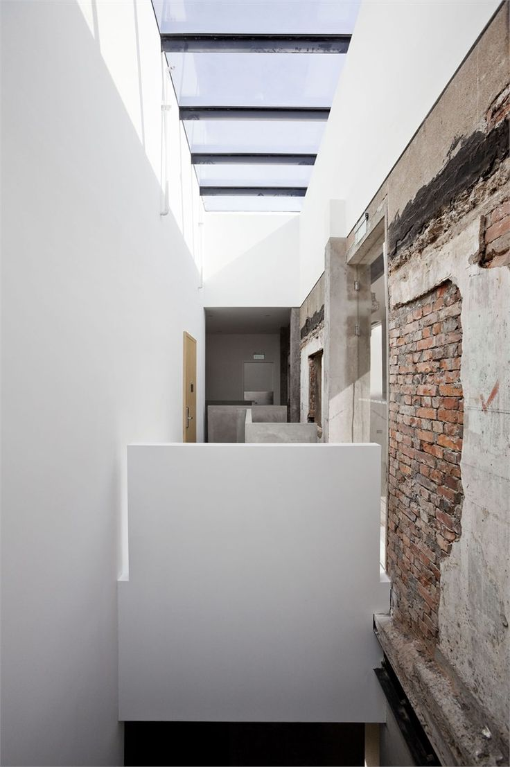 Exposed brick juxtaposed with crisp white walls