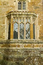 Aisle window, Frieze carvings, St Mary's Adderbury