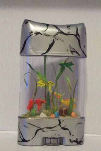 Pauline Kretler used a deodorant container to make a trash to treasure aquarium for a dolls house scene.