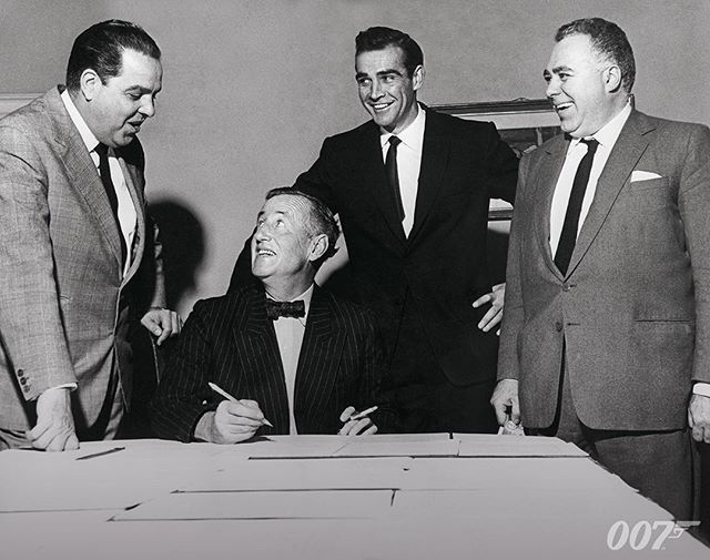 Harry Saltzman is posing for a publicity shot with producer Cubby Broccoli, Bond author Ian Fleming and the first James Bond actor Sean Connery, just before DR. NO started filming in 1961. #BTS