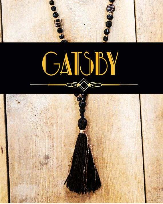 Gatsby Party Tassel Necklace  Add to your Gatsby party costume, hen party or wedding gift with a beautiful black and gold Gatsby necklace. All