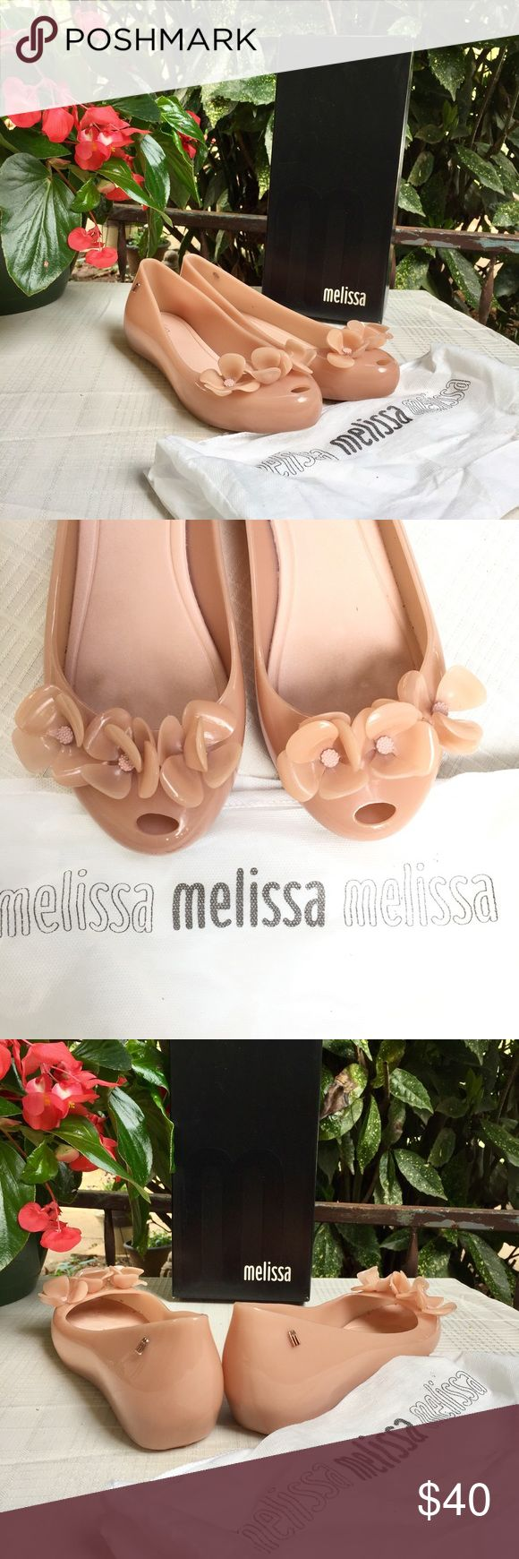 Melissa Ultragirl XI AD How cute are these? OMG! These are the Melissa Ultrgirl XI AD! They are light pink (ballet pink) with cute flowers at the toe. The rose gold style emblems set this shoe they are a size 9 and I only wore these once. I am in love with Melissa shoes (not just because it's my name) because they are so comfortable and they smell wonderful. Sale comes with shoes, dustbag, and box. Melissa Shoes Flats & Loafers