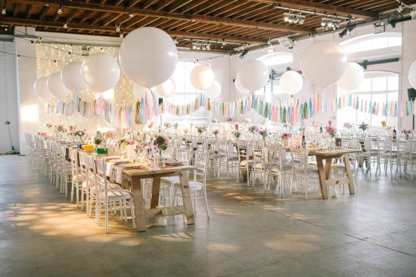 Giant balloons, sorbet color palette, and paper tassels
