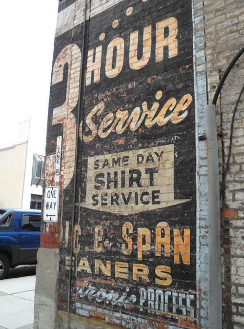 Awesome! Advertise your services on your building in a vintage style!