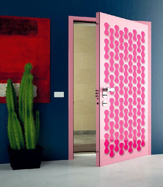 Pink and patterned! A most unusual, retro & safe (see the locks!) door.