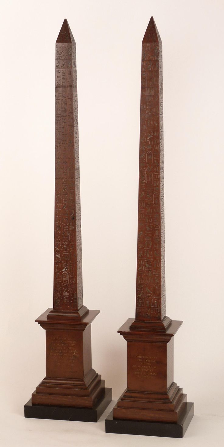A pair of Grand Tour rosso marble obelisks, 19th century, the obelisks profusely decorated with hieroglyphs and on stepped square plinths with Latin inscriptions, restored, 78cm high Sold for £6,300