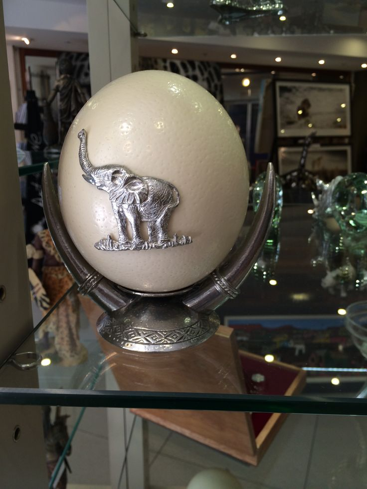 Ostrich egg with pewter elephant design.