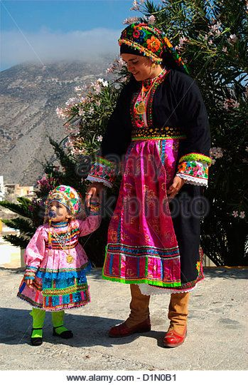 Young woman with her baby dressed traditional. Olympos Karpathos. Dodecanese's islands. Greece.Photo: greeceinvision. www.alamy.com.