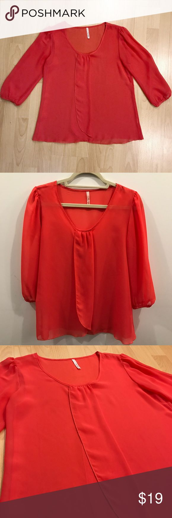 Bright Coral Blouse Unique flowy blouse in bright coral. Sheer material that overlaps and opens up in the front. Three-quarter sleeves. No flaws! Tops Blouses