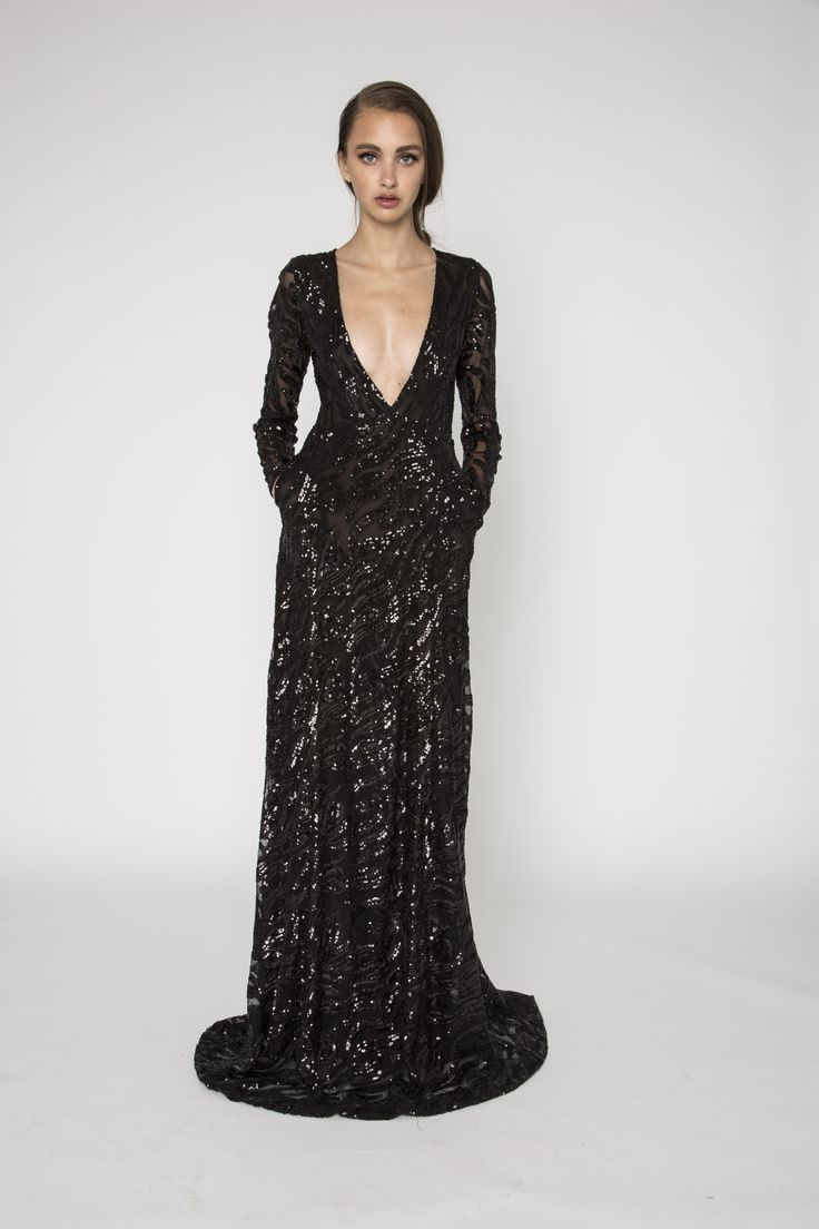 Sequin deep plunge gown with pockets. The Sammy dress is a stunning black sequin embellished gown. It features a deep V neckline, long sequins sleeves and is designed to be fitted at bodice and gradually flare at waist. This stunning dress is truly glamourous. #evening #handembellished #sequins #deepvneck #pockets #sleeves #NARCES