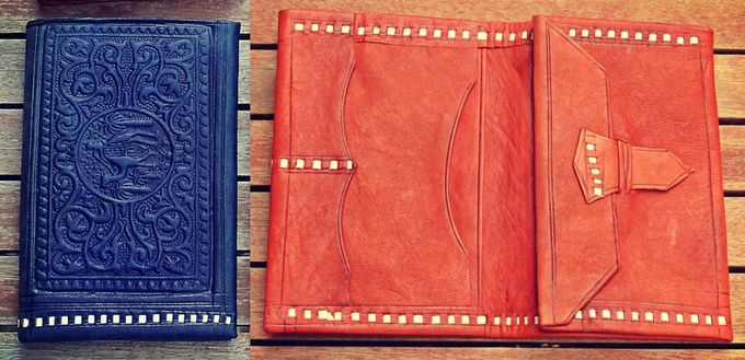 Leather Wallet : Embossed with traditional designs. Handmade and Handcrafted with soft Moroccan leather.  Fold over envelope style with various flaps and compartments. 8.5 cms x 12.5 cms closed. 18 cms x 12.5 when open.