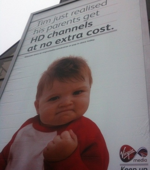 The Success Baby Meme appears on billboards.