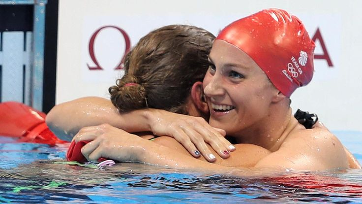 Great Britain's Jazz Carlin won her second silver medal of the Rio Games as Katie Ledecky set a new world record in the 800m freestyle to achieve a fourth gold.