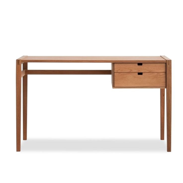 This desk gives a nod to the mid-century era, but is timeless in its quality and design. The desk has exposed mortise and tenon joinery and two dovetailed drawers resting on all wood slides. It also features sel