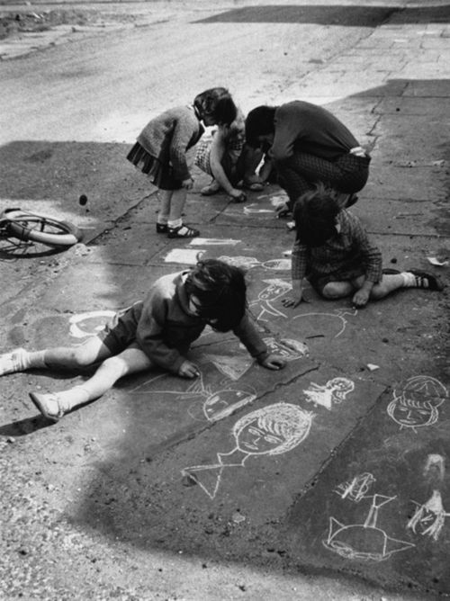 children draw on pavement with chalk, 1960s photo by shirley baker