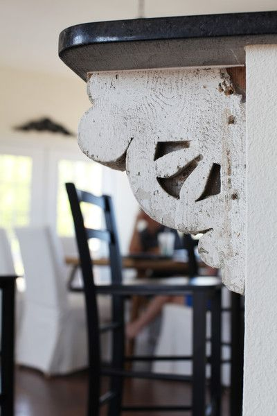 Using salvaged brackets is an easy way to add architectural interest to basic cabinetry, both at counter height and under cabinets | The Magnolia Mom - Joanna Gaines