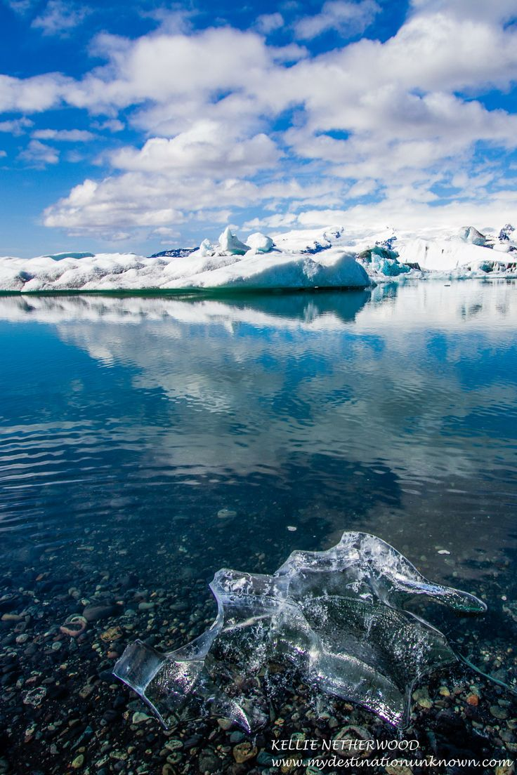 JOKULSARLON LAGOON, ICELAND - The first sight of naturally formed icebergs floating on crystal blue water at the bottom of a towering glacier is difficult to put into words.  It is simply a magical and silent scene that speaks volumes.