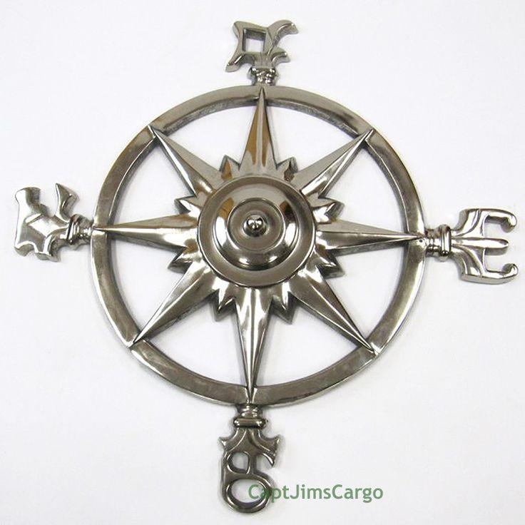 "CaptJimsCargo - XL Compass Rose 23"" Windrose Chrome Finish Nautical Wall Decor ,  (http://www.captjimscargo.com/nautical-home-decor/brass-spyglass-telescopes/xl-compass-rose-23-windrose-chrome-finish-nautical-wall-decor/) This decorative compass rose or windrose is made of solid aluminum with a chrome finish."