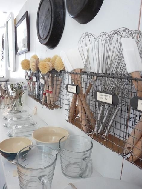 Love the idea of hanging wire baskets on the wall for kitchen utensils. Saves space on the counter.