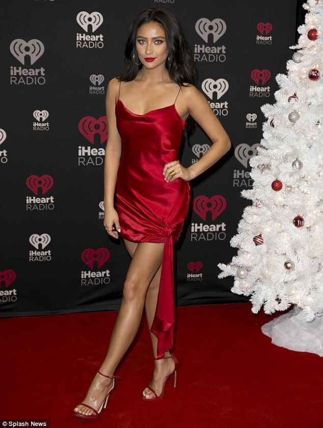 43c3c5e7e8 Shay Mitchell debuts colored contacts and red dress at Jingle Ball ...
