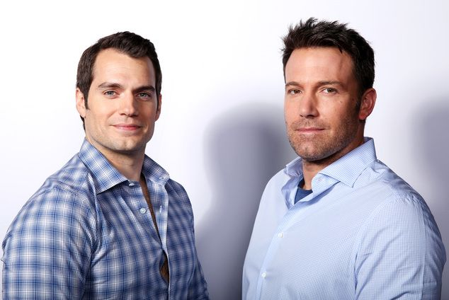 In this March 18, 2016 photo, Henry Cavill, left, and Ben Affleck pose for a…