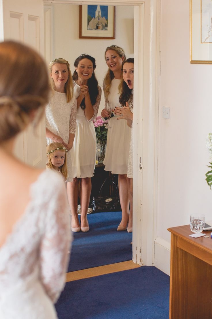 One of a set of images taken at the destination Wedding of Ceri and Fabian, set around the historical sites in Jersey. The Bridesmaids see the Bride. Photography by Matt Porteous & Max Burnett