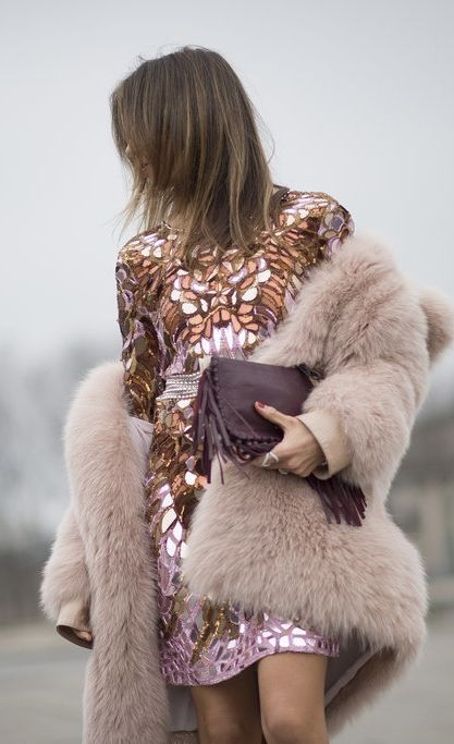 Paris Fashion Week street style: a mirrored pink dress, fluffy pink coat and fringe bag