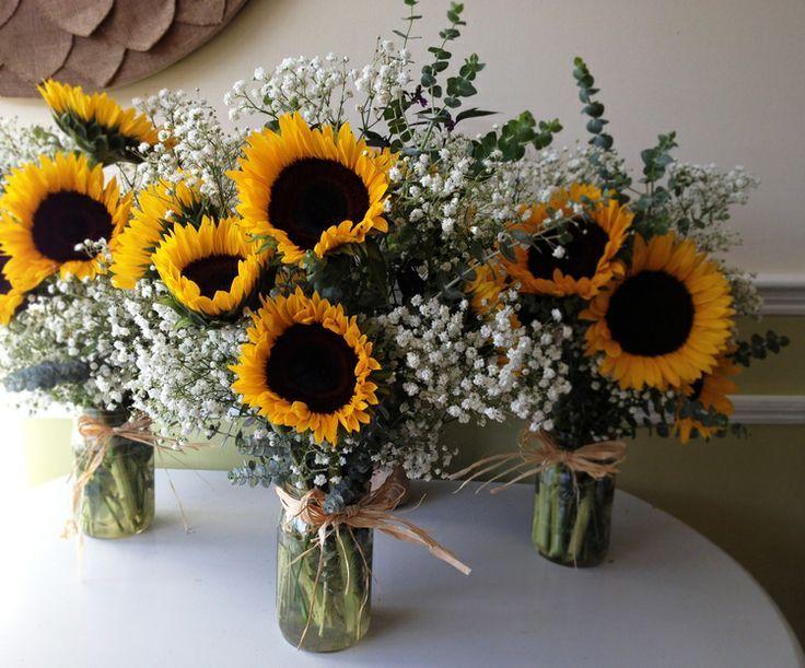 sunflower and baby's breath wedding bouquet arrangement                                                                                                                                                      More