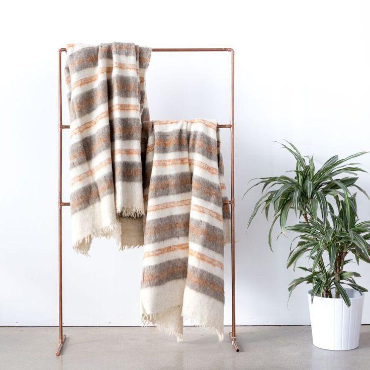 blanket / copper ladder / greenery & white