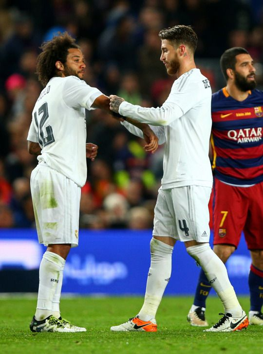 Sergio Ramos passes the captain's armband to Marcelo after receiving a red card during the La Liga match between Barcelona and Real Madrid at Camp Nou on April 2, 2016