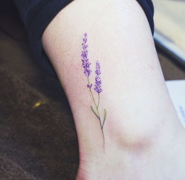 Very beautiful blue bonnet tattoo reminder of texas i love the placement and color original