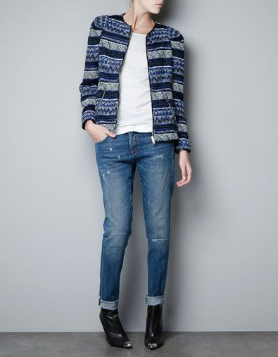Beautiful geometric cardi with zip - wear as jacket with pencil skirt, jeans or tailored trousers. Nice with navy jumper with silver pocket detail. Also good with grey pointelle jumper. Simple navy top and navy trousers will also look great with this statement jacket.