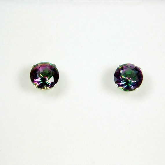 3.10 Carat Mystic Fire Rainbow Topaz Studs on .925 Sterling Silver   *3.10 Carat Mystic Fire Rainbow Topaz Studs  *Metal: .925 Sterling Silver  *Grade: AAA  *Cut: Round  View Similar Items  https://www.etsy.com/shop/Fashion365?section_id=16547568&ref=shopsection_leftnav_5  ----------------------------------------------------------------------------------------------------- Gemstone Information  Lab Created Gemstones  Lab created gemstones are made of the same mineral composition as natural…