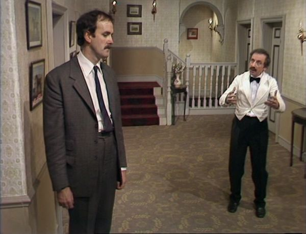 """John Cleese as Basil Fawlty and Andrew Sachs as Manuel, Fawlty Towers, """"The Psychiatrist"""""""
