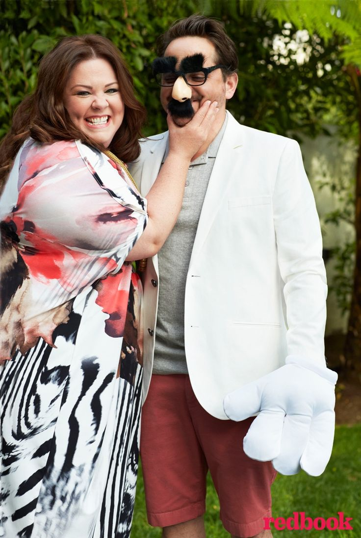 """Melissa McCarthy stars in the July cover story from Redbook Magazine, showing off her goofy side alongside her husband Ben Falcone. Inside the magazine, Melissa talks about her marriage and why she felt the need to start a plus-size clothing line. """"When I go shopping, most of the time I'm disappointed. Two Oscars ago, I couldn't find anybody to do a dress for me. I asked five or six designers—very high-level ones who make lots of dresses for people—and they all said no,"""" she reveals."""