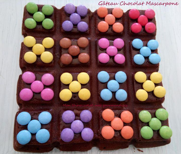 Bonjour à tous ! En sommeil depuis quelques jours je reviens vers vous avec une petite tuerie Show...colatée. Non Cyril Lignac n'a pas basculé dans la pâtisserie enfantine mais il s'agit bien d'une recette de base de son délicieux gâteau au chocolat et...