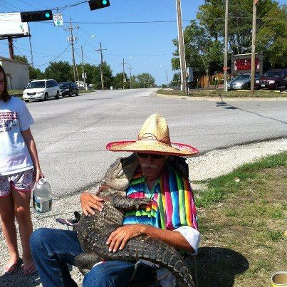 Driving down the street when I see a man sitting on the corner, cuddling with his best friend. - ImgurGator Humor, Random Funny, Awesome Pictures, Pets Gator, Laugh Allowance, Animal De, Funny Stuff, Crazy Things, Awesome Stuff