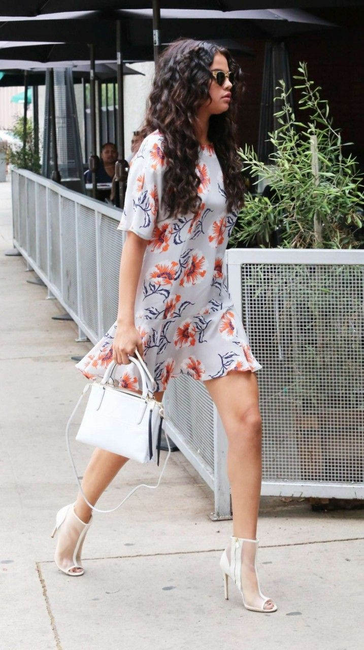Selena Gomez wearing Coach Borough Bag, Topshop Boutique Floral Flippy Dress, Jerome C. Rousseau Addict Mesh Booties and Urban Outfitters Skylar Sunglasses.