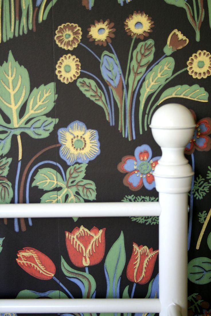Swedish design. Ikea iron bed against the Josef Frank wallpaper.