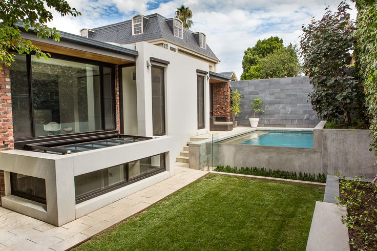 North Adelaide residence - concrete coping is extended down into the pool in a series of wide steps, broken up with the delicate mosaic tile of the pool interior.