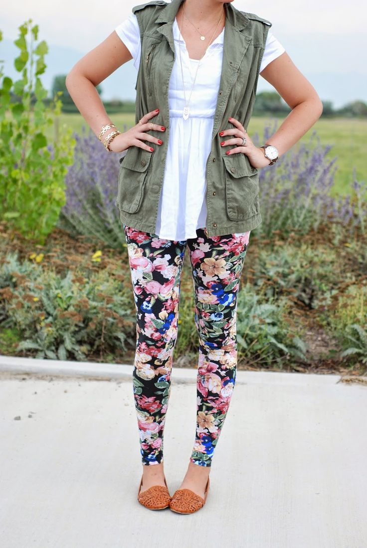 Layering with floral leggings and a utility vest with purple hair! Outfit from The Red Closet Diary fashion blogger.