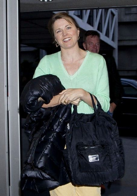 Lucy Lawless and her husband Robert Tapert prepare to depart at LAX (Los Angeles International Airport)