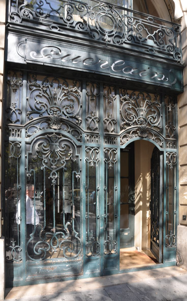 Portal of the building located at 68 avenue des Champs-Élysées in the 8th arrondissement of Paris in France. Built in 1914 for perfumers Jacques and Pierre Guerlain and registered historical monuments by the French Ministry of Culture.