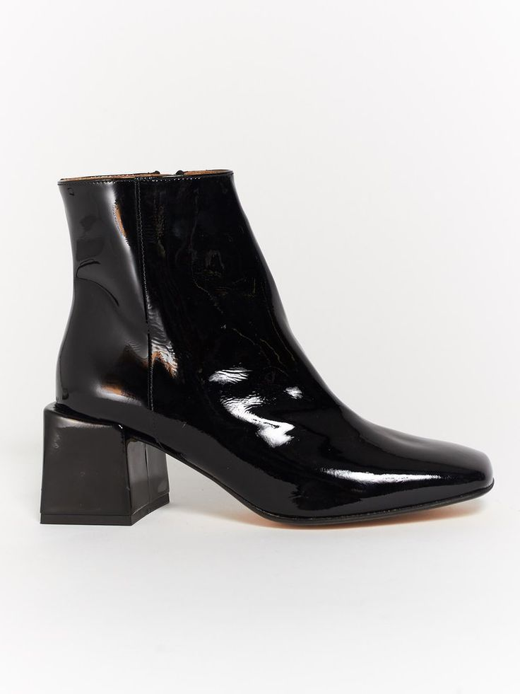 Structured patent Leather Ankle boot with Industrial inside metal zipper,  block leather covered heel and a square toe.