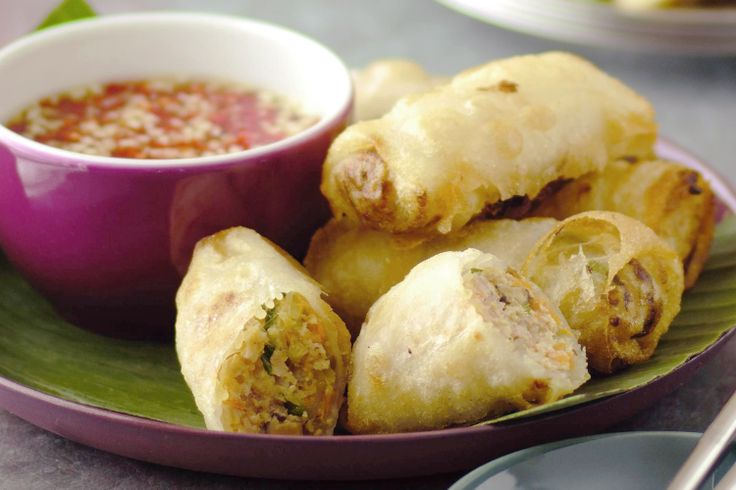 Enjoy these crispy crab and pork spring rolls Vietnamese style - wrap in lettuce and mint, then dunk in spicy sauce. The delicate rice paper makes these lighter and crispier than Chinese-style spring rolls.