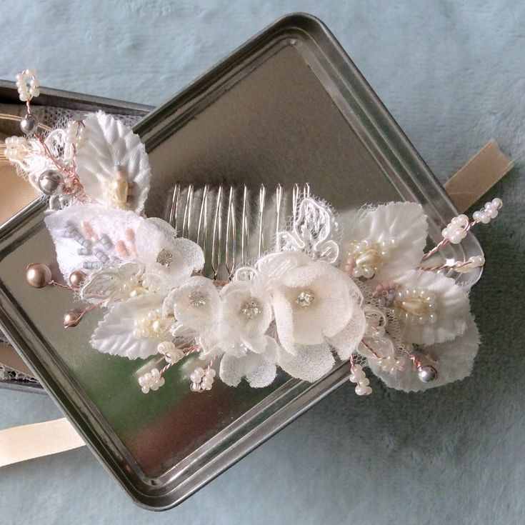 This delicate silk flower comb has made it as February's item! Experimenting with a bit if colour and hues of soft rose and smoke grey, perfect for spring!