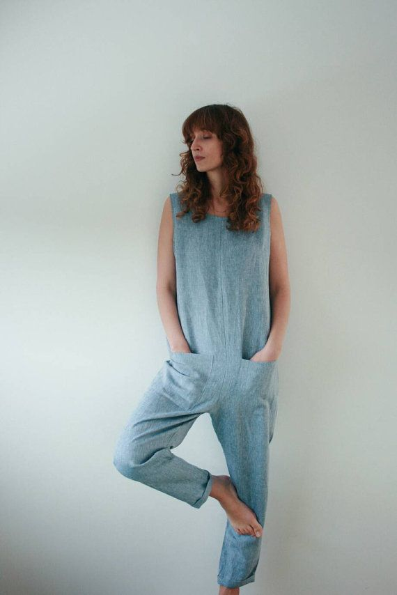 Light blue linen jumpsuit, handmade in our cozy studio. This linen overall is very comfortable and has a minimalistic look. Made from organic linen fabric and is perfect for spring and summer seasons.  Please be advised that: with loose-fitting silhouettes, expect greater allowances for a looser fit. If, however, you do not want too loose a fit, you can choose a smaller size. This linen overall is made of beautiful organic linen fabric (100% linen).  Silhouette: - classic overall, with an…