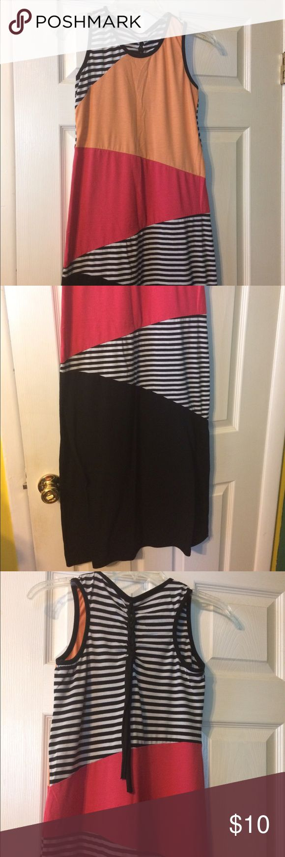 Pink, peach, striped dress 👗 Very comfortable! Bought several years ago, but I haven't wore it that much. Braid closure and ties on the back. No flaws that I know of. There is a few little balls under one armpit but it's not very noticeable. GIRLS size!! 😀 It's Fashion Dresses Maxi